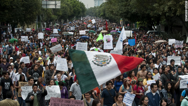 Thousands of protesters take to the streets in Mexico City on Monday, a day after the presidential election results were announced. Supporters of the opposition candidate were rallying against Enrique Pea Nieto, who declared victory late Sunday.