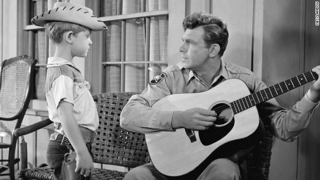 Griffith plays the guitar for his television son, Opie, during &quot;The Runaway Kid.&quot;