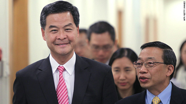 The new Hong Kong Chief Executive Leung Chun-ying (L) has faced widespread backlash from the public.
