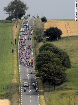 The peloton, the main group of riders, descends a hill during Stage 3.