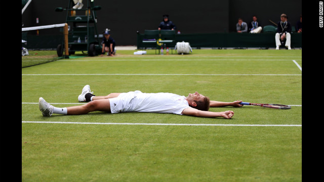 Florian Mayer of Germany celebrates match point during his men's singles fourth round match against Richard Gasquet of France on Day Eight of the Wimbledon Lawn Tennis Championships in London on Tuesday. The grand slam event runs through July 8.