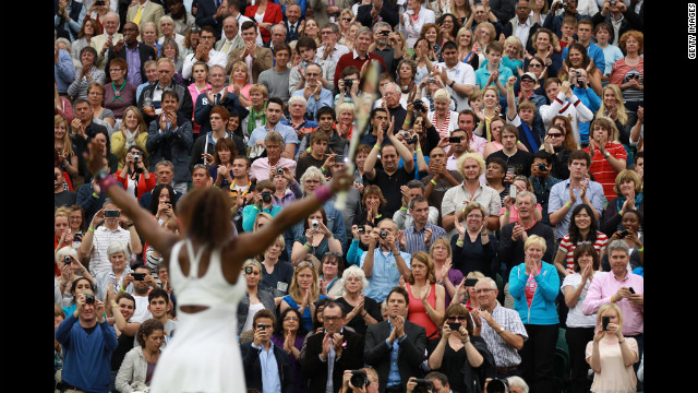 Williams celebrates after beating Kvitova in the Ladies' Singles quarterfinal match.