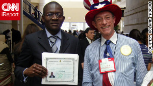 Roland Tadoum poses with a volunteer after receiving his certificate of naturalization in 2007.