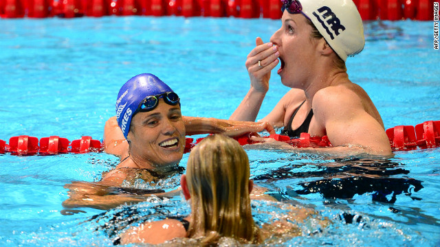 After her fourth-place finish in the women's 50-meter freestyle final, Dara Torres, center, turns to winner Jessica Hardy on the last day of the 2012 U.S. Olympic Swimming Team Trials in Omaha, Nebraska, on Monday. Kara Lynn Joyce, top, reacts to finishing second, which secures her slot to compete in London.