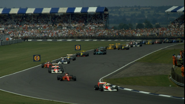 F1 legend Ayrton Senna leads the field during the first lap of the British Grand Prix in 1990, a year that major revisions were made to the circuit.