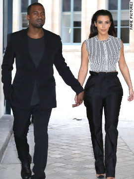 Kanye West and Kim Kardashian head to a fashion show in Paris.