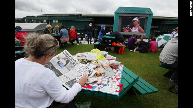 The crowd on Murray Mount watches the action or finds other entertainment on Day Nine of Wimbledon.