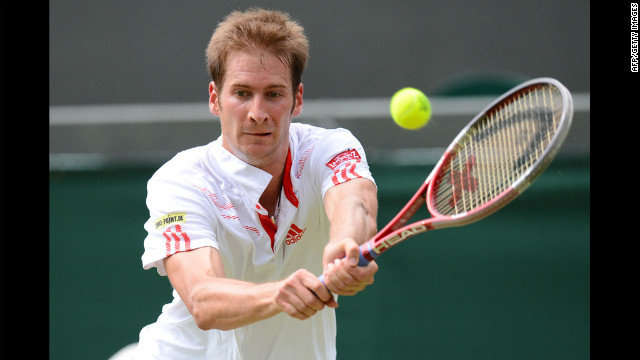 Mayer plays a double-handed backhand shot during his men's singles quarterfinal match against Serbia's Novak Djokovic.