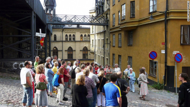 Fans of the Millenium trilogy by Swedish author Stieg Larsson gather at Bellmansgatan 1, the supposed address of Mikael Blomkvist, the hero of the saga, in a guided tour of Stockholm.