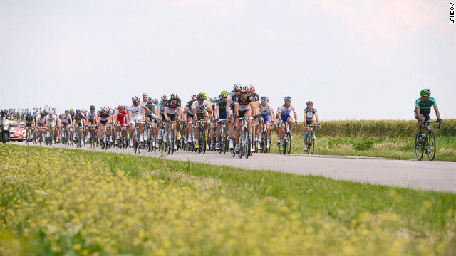 The pack of cyclists streams along a country road during Stage 4.