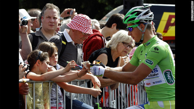 Liquigas-Cannondale rider Peter Sagan of Slovakia signs autographs for spectators.