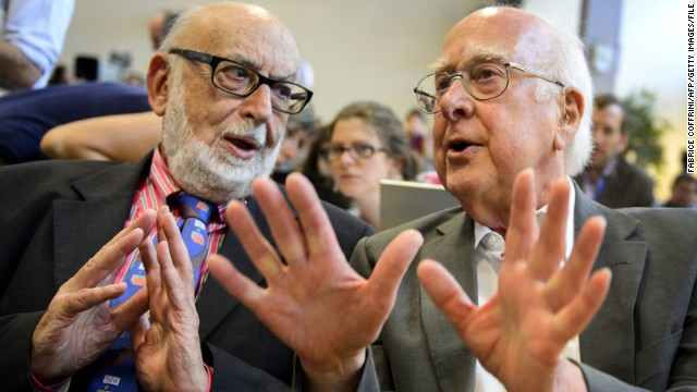 British physicist Peter Higgs, right, speaks with Belgian physicist Francois Englert at a press conference at CERN in 2012. Higgs and Englert shared the 2013 Nobel Prize in Physics for describing an explanation for why particles have mass. They independently published papers on this topic in 1964.