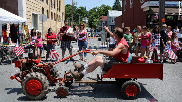 Residents watch the annual Liberty Festival parade on Wednesday in Liberty, New York.