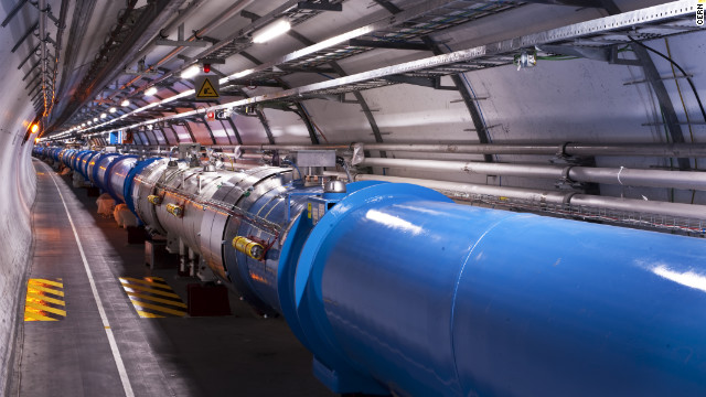 The LHC is a circular tunnel located 100 meters (328 feet) underground, which uses a particle accelerator to collide protons at extreme speeds.