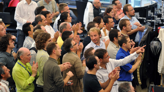 CERN scientists applaud at the main control center near Geneva during the switch-on operation of the LHC on September 10, 2008.