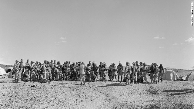 "Vietnamese-born An-My Lê's photographs in the ""29 Palms"" series show U.S. troops preparing for deployment, enacting scenarios in a virtual Middle East in the California desert. This photo is called ""Debriefing.""<br/><br/>"