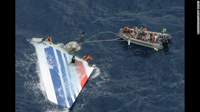 On June 1, 2009, Air France Flight 447 plunged into the Atlantic Ocean en route to France from Brazil, killing all 228 passengers on board. Six days later, on June 7, Brazilian Air Force crew members prepare to tow part of the wreckage from the Atlantic Ocean.