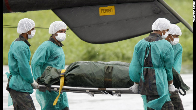 Brazilian Air Force personnel unload the remains of a passenger on June 9, 2009. France's Bureau of Investigation and Analysis said the data indicated that Flight 447 crashed because the aircraft's speed sensors gave invalid readings.