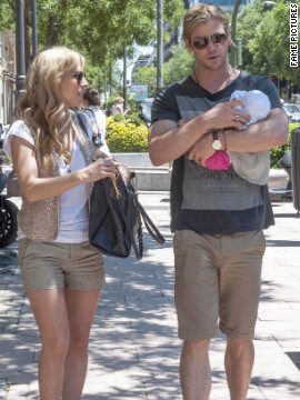 Elsa Pataky and Chris Hemsworth roam around Madrid with their baby.