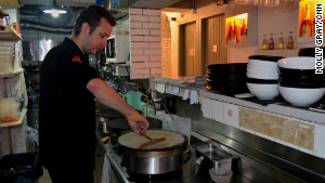 Fleur de Sel owner and head chef Gregory Alexandre cooks one of the kitchen\'s most popular teatime crepes.