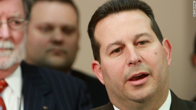 Jose Baez, lead defense counsel for Casey Anthony, answers questions after jurors reached their verdict last year. Co-counsel Cheney Mason looks on.