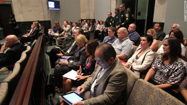 Spectators in the courthouse wait for the trial's first day to begin on May 24, 2011.