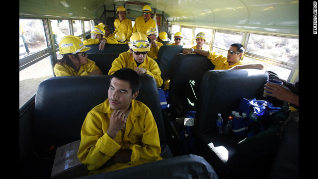 Firefighter Ryan Christian sits with his crew from Alaska before heading out to fight the Fontenelle Fire outside Big Piney. The blaze, burning in dead and thick stands of timber, started on June 24 and is 15% contained. 