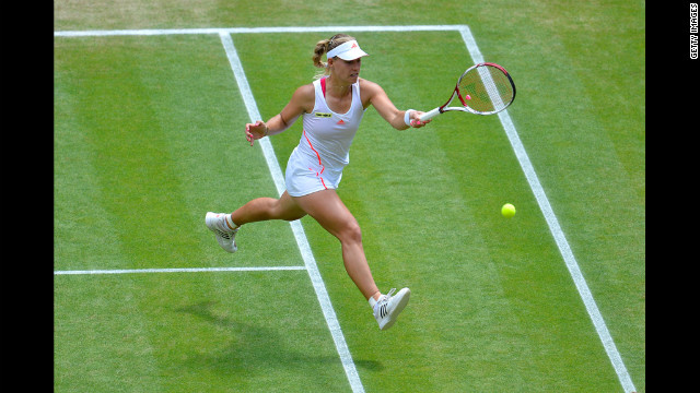 Kerber returns a shot during her Ladies' Singles semifinal match against Radwanska.