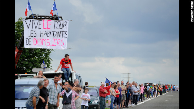 Fans line the road and wait for riders to pass along the 196.5-kilometer (122-mile) Stage 5 course Thursday.