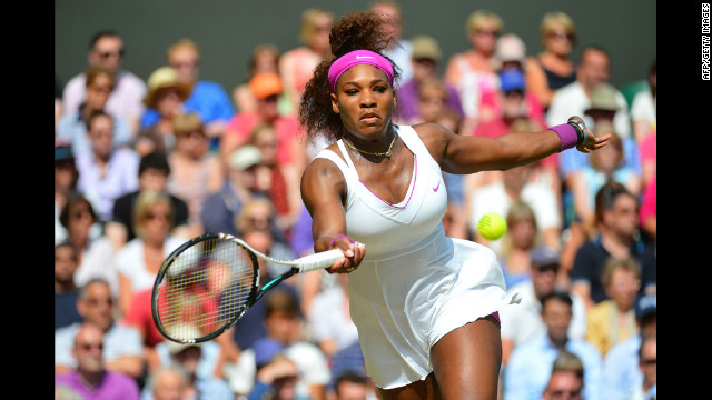 Serena Williams takes a forehand shot during her women's singles semifinal match against Belarus' Victoria Azarenka on day 10 of Wimbledon.