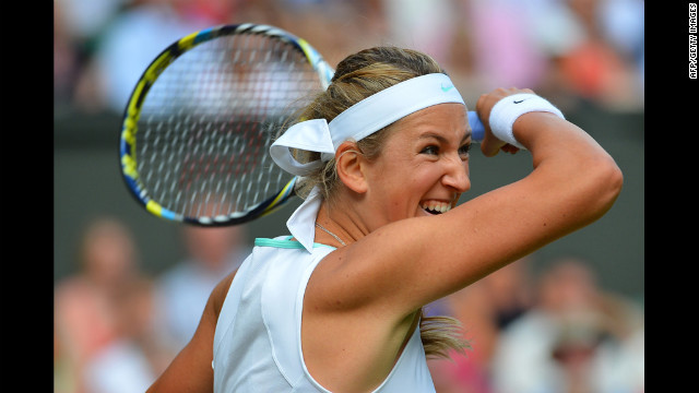 Belarus' Victoria Azarenka takes a hard shot during her women's singles semi-final defeat by U.S. player Serena Williams on Thursday.