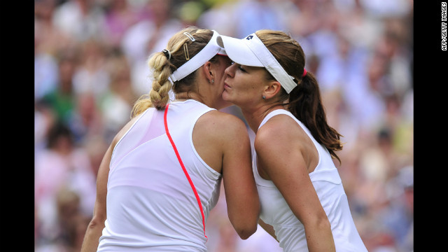Poland's Agnieszka Radwanska embraces Germany's Angelique Kerber, left, after her women's singles semi-final victory on Thursday.