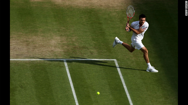 Colin Fleming of Great Britain runs to keep the ball in bounds while playig with Su-Wei Hsieh of Taipei during their mixed doubles third-round match against Laura Robson and Dominic Inglot of Great Britain on Thursday.