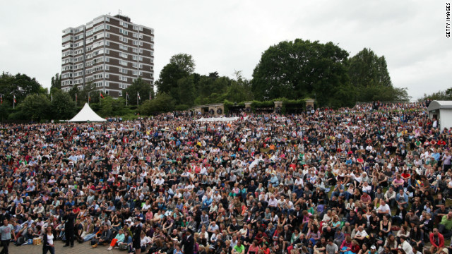 "It has become a Wimbledon tradition for fans to gather on a large grassy bank outside of Centre Court to watch games on a large screen. The area was once known as ""Henman Hill"" and has since been rechristened ""Murray Mound""."