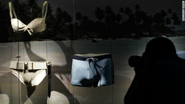 "The bikini worn by Honey Ryder, the first Bond Girl in ""Dr. No,"" sits alongside the famously tiny trunks worn by current Bond actor Daniel Craig in 2006's ""Casino Royale."""