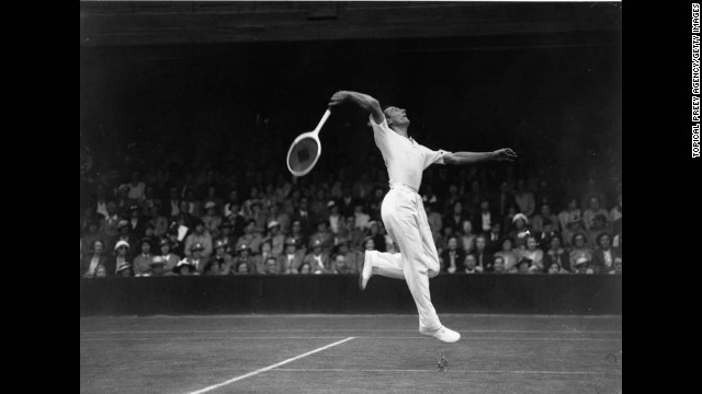 Perry returns a serve against U.S. player Bryan Grant in Court Number One at Wimbledon on June 29, 1936.