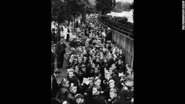 Crowds queue outside the gates of the All England Club in London to see the Wimbledon men's singles final between Perry and von Cramm on July 3, 1936.