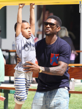 Usher takes his sons to a playground in Malibu.
