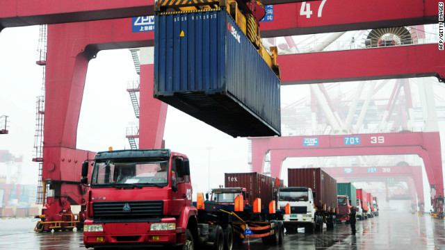 Containers been loaded on to a ship at the Qingdao port, in northeastern China's Shandong province on March 9, 2012. 