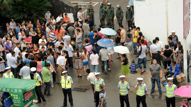 Police guard government offices in Shifang after authorities bowed to violent protests against a chemical plant.