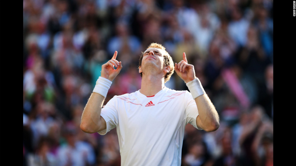 Andy Murray of Great Britain celebrates the winning point during his men's singles semifinal match against Jo-Wilfried Tsonga of France at Wimbledon on Friday. He is the first British player to move past this leg of the tournament in 74 years. To view Britain's last Wimbledon champ, <a href='http://www.cnn.com/2012/07/06/world/gallery/fred-perry-wimbledon/index.html'>click here</a>.