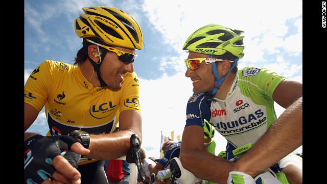 Race leader Fabian Cancellara chats to Ivan Basso of Italy at Stage 5, from Rouen to Saint-Quentin, on Thursday, July 5.