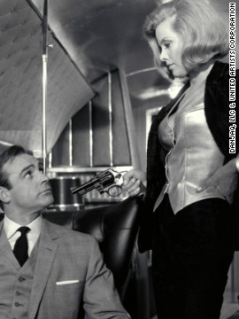 Pussy Galore, played by Honor Blackman, and Sean Connery as Bond, in 1964's &quot;Goldfinger.&quot; 