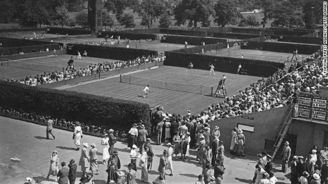 Crowds watch the tournament on the first day of the matches on June 22, 1936. See the best photos from this year's Wimbledon competition.