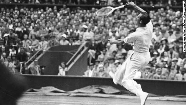 "Fred Perry jumps for the ball against Germany's Gottfried von Cramm during the men's singles final on July 3, 1936. Perry defeated von Cramm that year to win his third straight title. But since then no male from the UK has won his country's most coveted title, and none had even made it to the final since Henry Wilfred ""Bunny"" Austin in 1938. Thus, the eyes of the nation will be upon Andy Murray on Sunday in the 2012 championship match against six-time champion Roger Federer of Switzerland."