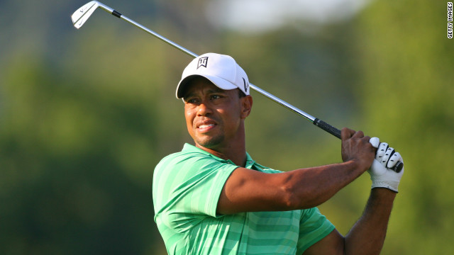 Tiger Woods plays an approach in gathering gloom at the Greenbrier Classic where he missed the cut.