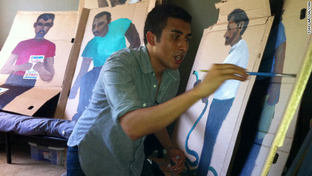 Artist Ramiro Gomez, 25, paints life-size figures of immigrant workers on cardboard boxes.