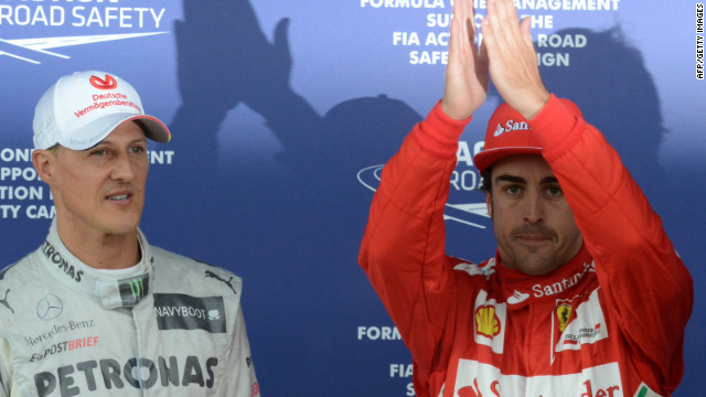 Fernando Alonso (right) celebrates his pole at Silverstone with third-fastest Michael Schumacher