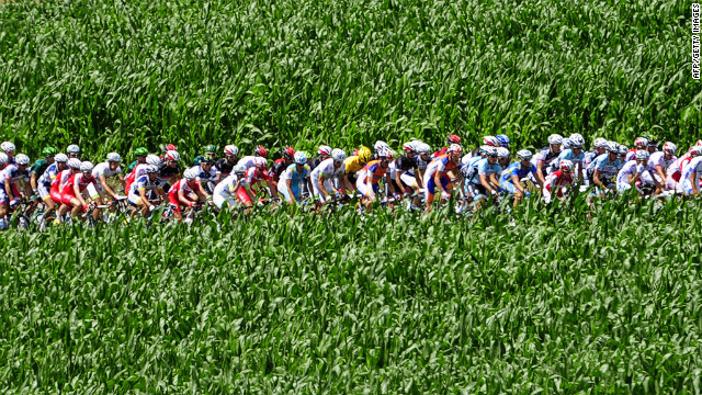 The pack rides by during the seventh stage of the 2012 Tour de France.