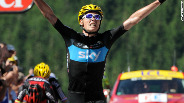 Chris Froome crosses the line in triumph to win the seventh stage of the 2012 Tour de France.